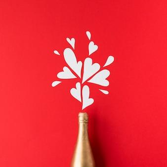 Flasche alkohol und ornament herzen