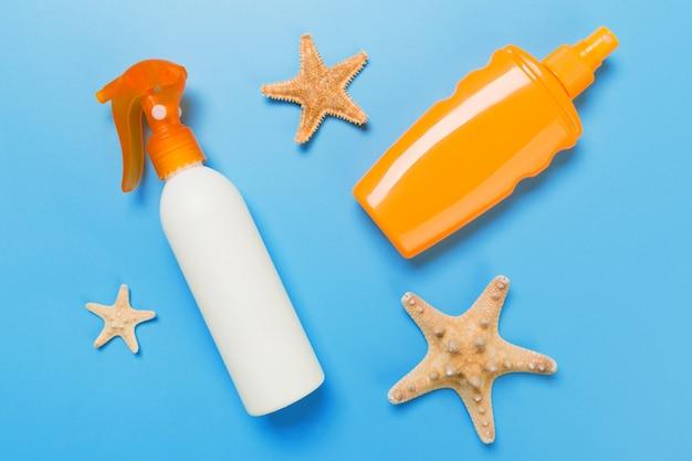 Flasche sonnencreme mit muscheln
