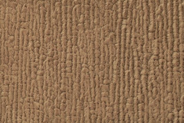 Flaumiger hintergrund browns des weichen, flaumigen stoffes. beschaffenheit der textilnahaufnahme