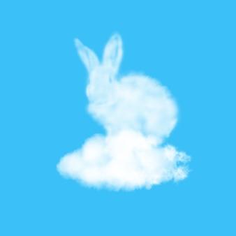 Flauschiger osterhase gemacht von der weißen wolke auf einer pastellhimmelblauen oberfläche mit kopienraum. glückwunsch frohe osterkarte.