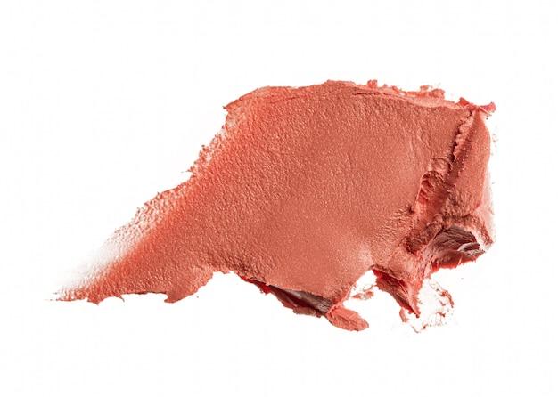 Flecken eines rosa lippenstifts lokalisiert auf weiß