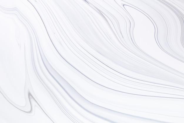 Fließende kunstbeschaffenheit. abstrakter hintergrund mit mischfarbeneffekt. flüssiges acryl-kunstwerk mit flüssen und spritzern.
