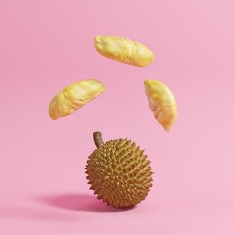 Float durian auf rosa pastell hintergrund. minimales konzept.