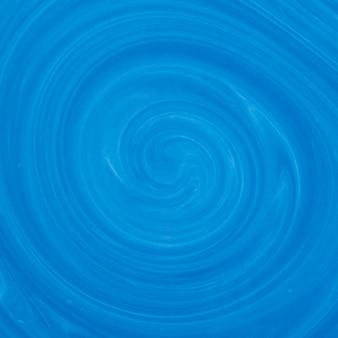 Flüssiger kunsthintergrund der blauen und weißen strudelfarbmischung