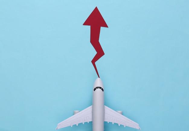 Flugzeug mit wachstumspfeil auf blauem