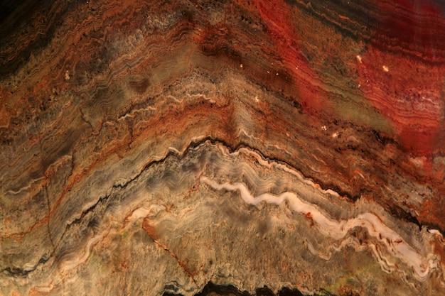 Folda quartsit stein bunte textur mit streifen polierter metamorpher steinhintergrund mit geschwungenen streifen
