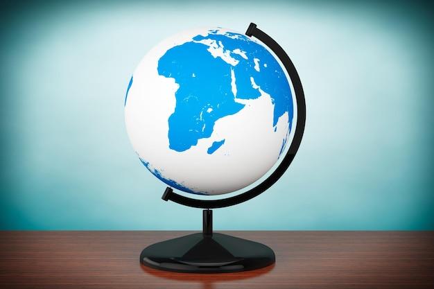 Foto im alten stil. welt-desktop-globus auf dem tisch
