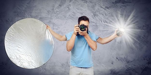 Fotograf mit vier armen