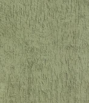 Fragment der hauswand mit strukturiertem putz bedeckt. strukturierte grüne farbe handgemachte oberfläche für hintergrund.