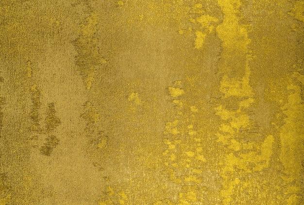 Fragment des bunten retro-wandteppich-textilmusters mit goldstruktur