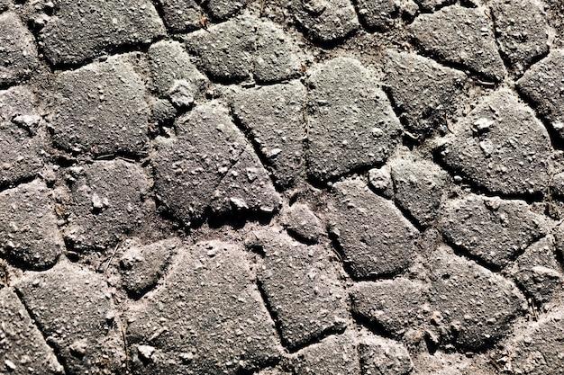 Fragment einer wand von einem abgebrochenen stein