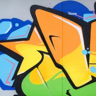 Fragment von farbigen straßenkunst-graffitimalereien mit konturen und nahem hohem der schattierung