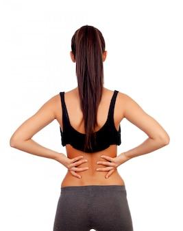 Frau in der sportkleidung mit rückenschmerzen