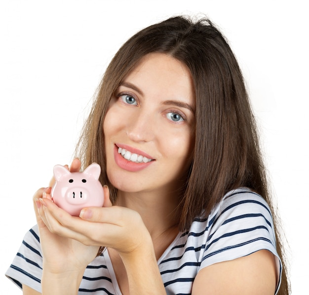 Frau mit einem sparschwein. isoliert