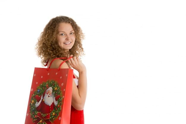 Frau mit einem weihnachtsbeutel