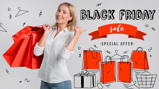 Frau mit einkaufstüten am schwarzen freitag