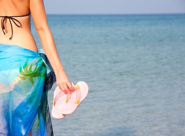 Frau mit flip flops
