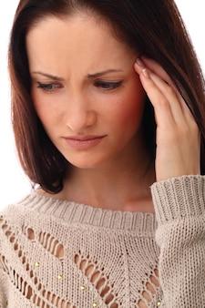 Frau mit stress oder kopfschmerzen