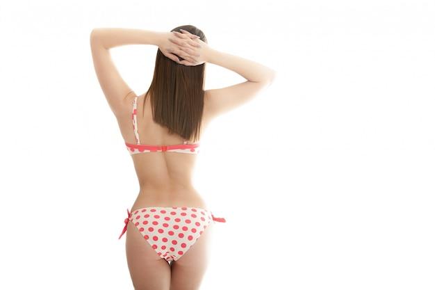 Frau zurück in bikini