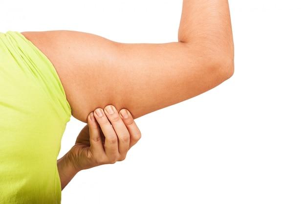 Frauen zeigen fette falte des achselhöhlenisolathintergrundes