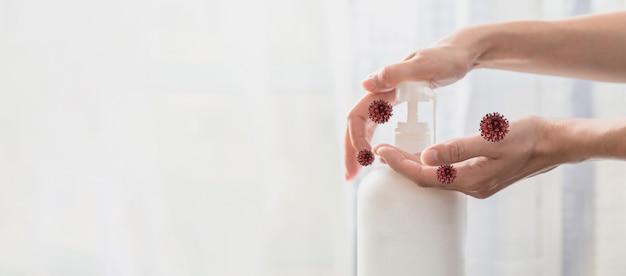 Frauenhände, die pumpplastikseifenflasche mit viren herum schieben, coronavirus-schutzkonzept