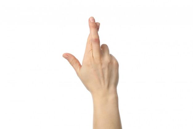 Frauenhand mit gekreuzten fingern lokalisiert auf weißem hintergrund