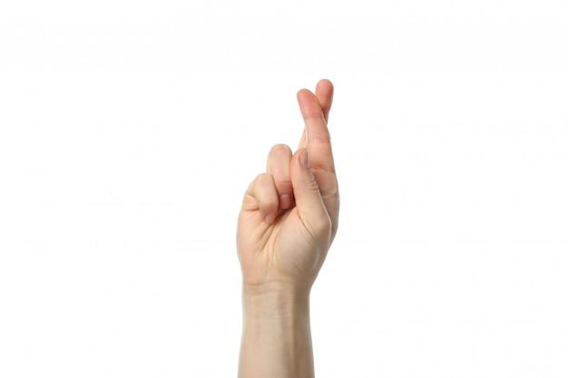 Frauenhand mit gekreuzten fingern lokalisiert auf weißer oberfläche