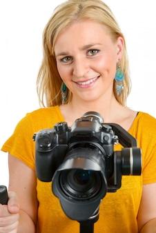 Frauenvideograf, der unveränderlichen nocken, auf weiß verwendet