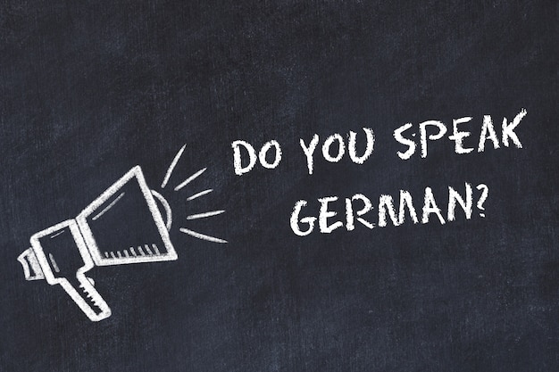 Fremdsprachenkonzept lernen. kreidesymbol des lautsprechers mit phrase sprechen sie deutsch