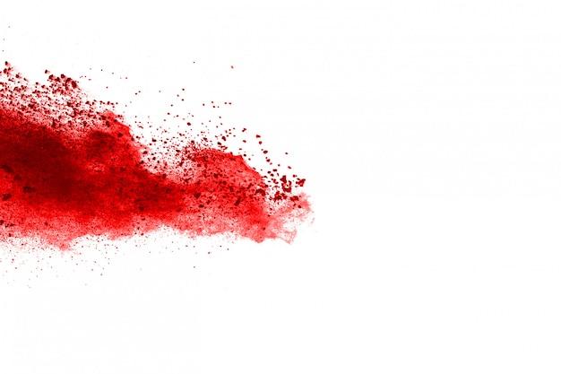 Frieren sie die bewegung des roten pulvers explodierend ein, lokalisiert