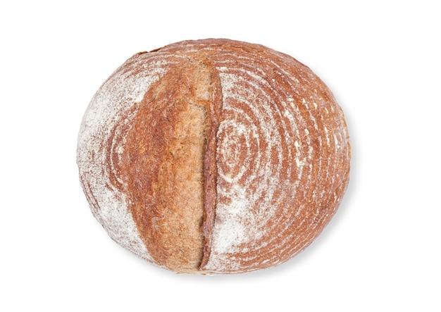 Frisch gebackener brotlaib mit mehl