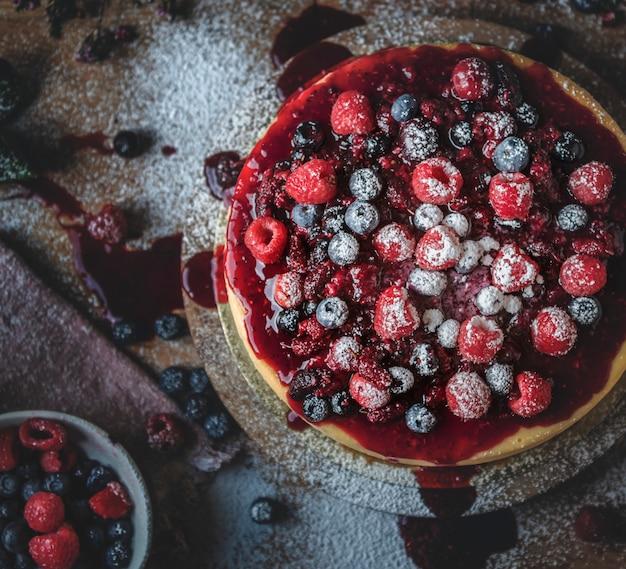 Frische beerenkäsekuchennahrungsmittelphotographie-rezeptidee