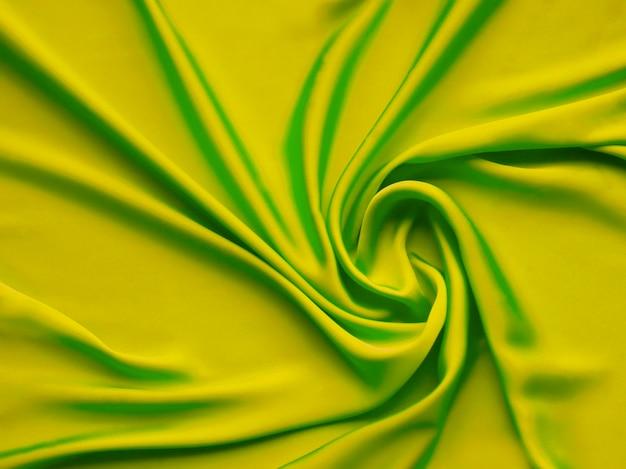 Frische grüne glatte elegante luxuriöse blaue satinhintergrundbeschaffenheit nah oben - abstrahierte tapete