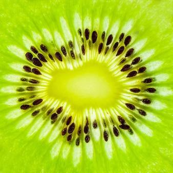 Frische kiwi-frucht schneidet nahaufnahme-makrotexturhintergrund