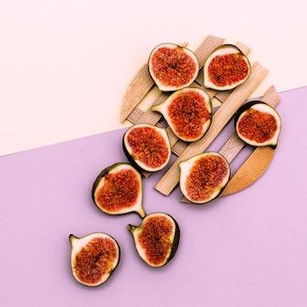 Frische leckere feigen. rohe früchte vitamine konzept flach laienkunst