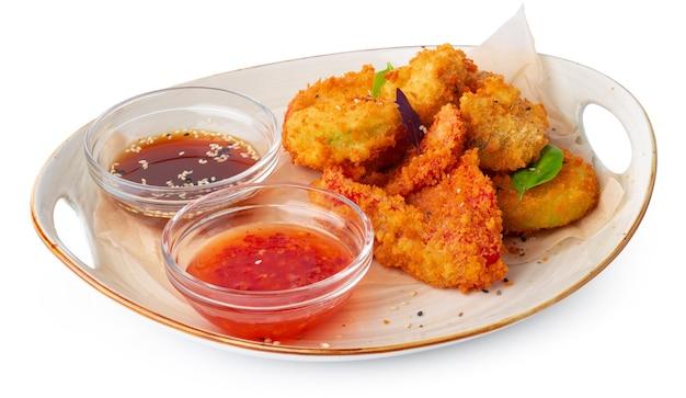 Frittierte chicken nuggets isoliert auf weißem hintergrund Premium Fotos