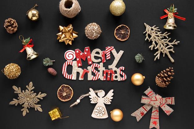 Frohe weihnachten-konzept auf schwarzem hintergrund