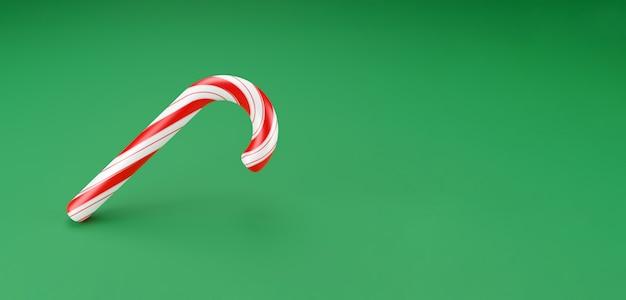 Frohe weihnachten stöcke, lollipop minzbonbons mit roten streifen auf grünem hintergrund. neujahrsfeier konzept. traditionelles süßes dessert. 3d-rendering