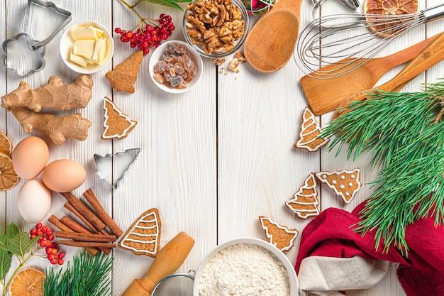 Frohe weihnachten und ein glückliches neues jahr kulinarischem hintergrund mit ingwerplätzchen