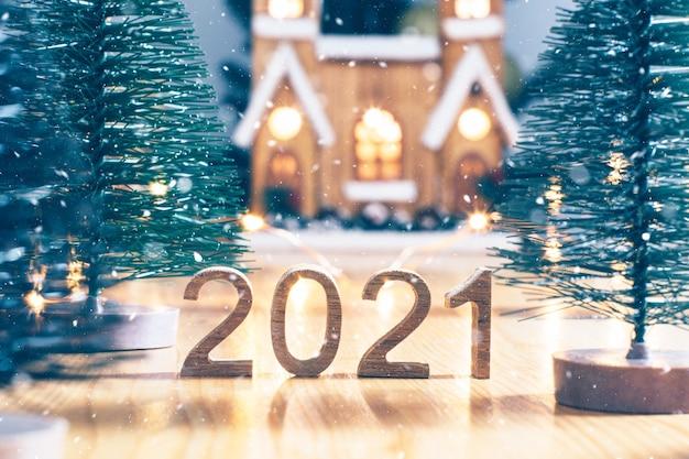 Frohes neues jahr. symbol ab nummer 2021 auf holz
