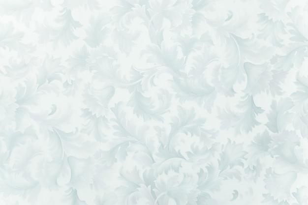 Frostiges muster in form von blüten und blättern. winterhintergrund