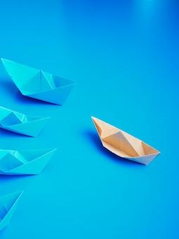 Führungskonzept-origamibootspapier
