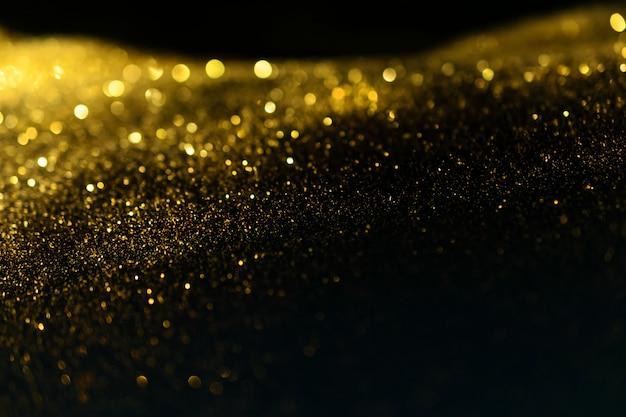 Funkeln beleuchtet grunge hintergrund, defocused abstrakter funkelnder lichthintergrund des goldfunkelns.
