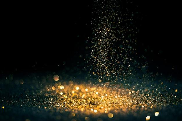 Funkeln beleuchtet schmutzhintergrund, defocused abstraktes twinkly gold des goldfunkelns beleuchtet hintergrund.