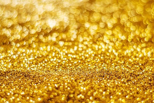 Funkeln helles abstraktes goldbokeh unscharfer hintergrund