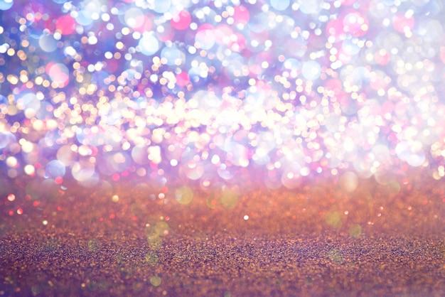 Funkelngoldweinlese beleuchtet beschaffenheitshintergrund. defokussiert
