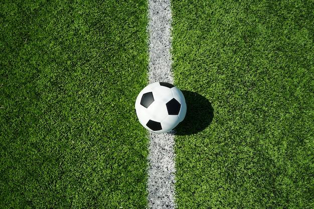 Fußball mit grünem glas