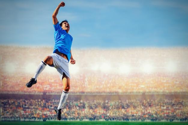 Fußballfußballspieler im blauen teamkonzept, das ziel im stadion während des spiels feiert