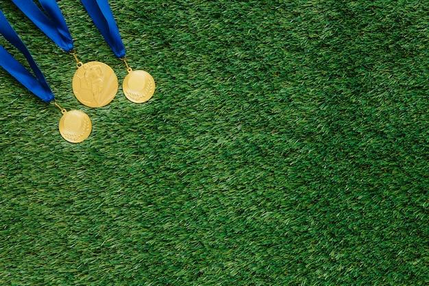 Fußballhintergrund mit medaillen und copyspace