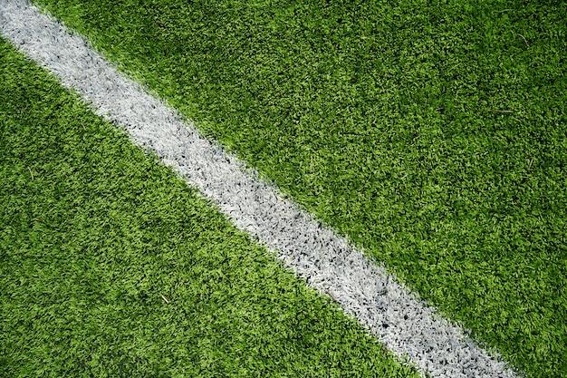 Fußballplatz mit grünem glas